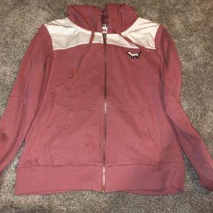 gently used pink zip up hoodie